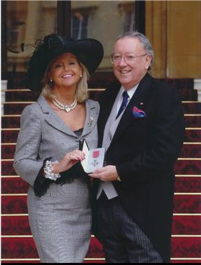 Bob-and-his-partner-Laura-with-his-MBE-13.jpg
